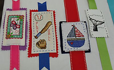 Stitching for Literacy: embroidered bookmarks donated by the Redwood Stitchers chapter of EGA