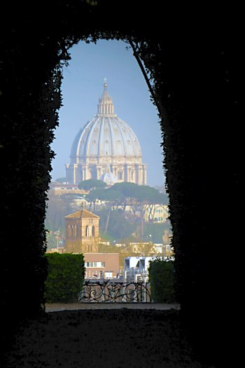 St. Peter's dome through an arch of greenery