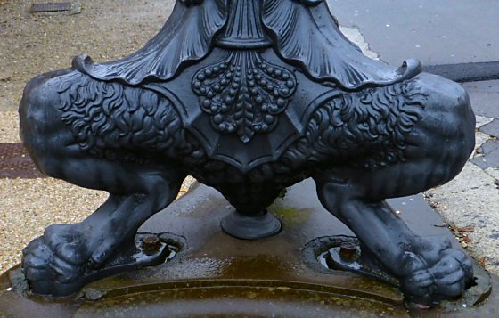 Bent lion legs with feet serve as the base of lampposts.