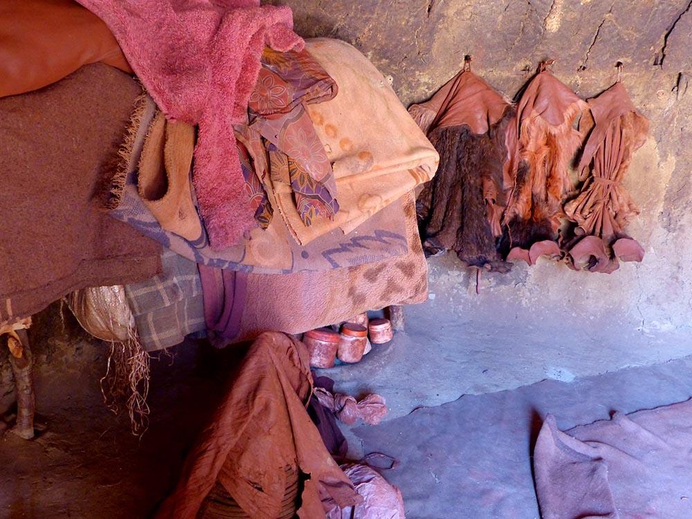Inside a mud hut.