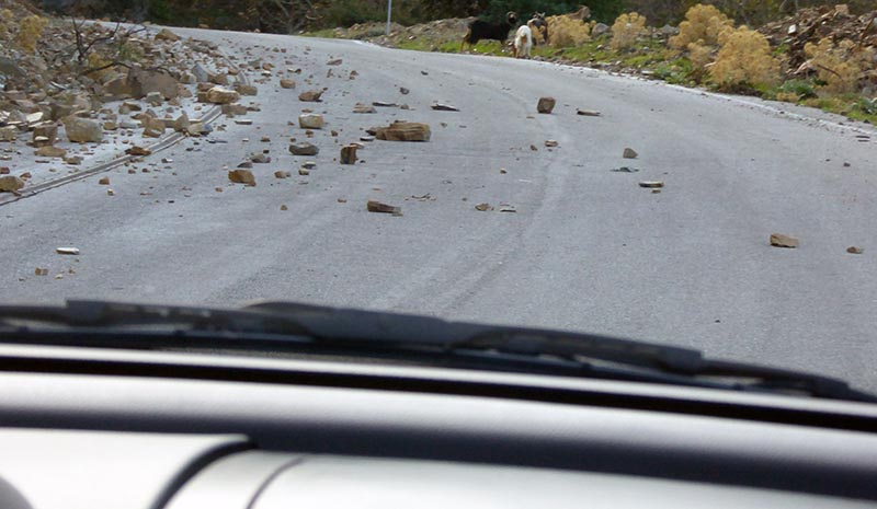 Rocks on road, driving on Crete - Jen Funk Weber